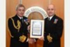 Navy man Ian's  commendation from fleet commander